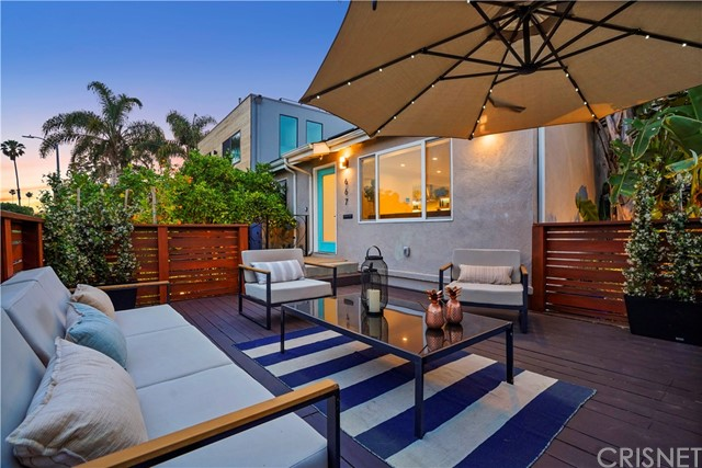 All the best of hip, trendy, artistic and warm vibes come together in this amazing Venice beauty. Everything has been remodeled with the finest care and highest quality craftsmanship. Caesarstone counters, porcelain tile, premium flooring, Viking appliances. Two full en-suite master bedrooms each with large walk in closets and finely renovated bathrooms, plus a 3rd bedroom/office and hallway powder room/bathroom. Energy efficient home with tankless water heater, eco-friendly e-control systems, and FULLY PAID solar electric system. Smart systems throughout including state of the art security/camera system. Gorgeous landscaping surrounding. Fruit trees. Tranquil backyard. Front deck/patio is a perfect place to relax and watch the world go by. Corner street to street lot with direct access to garage from side street and access from behind street. This home is CLOSE to everything - boutique and traditional shops, cafes, restaurants, entertainment and world renowned beaches. This home will leave you breathless. Come see it today and fall in love.