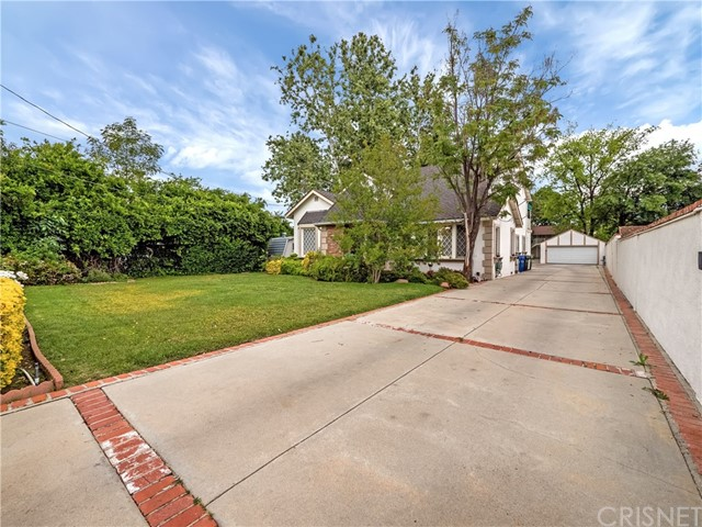 Must See!! Situated in the desired enclave of homes of Melody Acres in Tarzana. This gated, charming estate is unique & expansive appx 21,641 SF (0.5 acres) property featuring a 5,931 SF house, a Fabulous Swimming Pool and Waterfalls, and a beautifully landscaped backyard designed exclusively for entertaining and privacy. It features a total of 8 Bedrooms and 7 Bathrooms, a pool house with its own bathroom, a separate guest house ADU with separate entrances, RV parking, and a detached 2 car garage. The main house has 5 bedrooms and 4 bathrooms 3,381 Sqft, the 2 story guest house has a top unit with 2 bedrooms 2 bathrooms with a kitchen 1,050 Sqft, a second unit on the first floor has 2 bedrooms 2 bathrooms with additional 1,050 Sqft, a and the pool house has 1 bathroom 450 Sqft. This is the perfect house, located close to shopping and restaurants; it suits extended families. The scale & layout of this property is an entertainers dream.