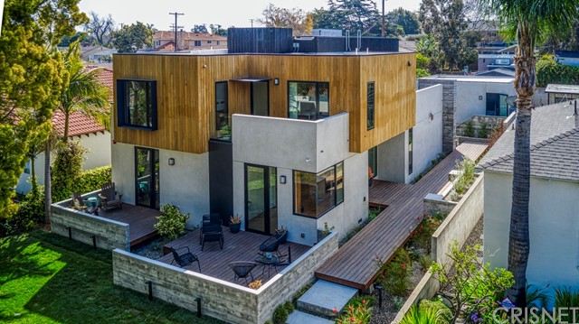 """Welcome to Kansas, an award winning family home on a quiet cul-de-sac in Sunset Park of Santa Monica. Completed in 2020 by Farnsworth Builders and designed by AAHA Studio. """"Best of La Cantina 2020"""" award winner and submitted for the prestigious AIA Award. This contemporary residence is defined by large volumes strategically offset to create entry points, outdoor terraces, and shading throughout the day. A floating full-length boardwalk draws you through to the side/main entrance surrounded by lush new landscaping. The main living space with entertainers kitchen, is anchored by a 22' wide sliding glass pocket door for that indoor/outdoor living experience. Polished concrete floor runs continuously from the kitchen through the back yard with the door track surgically embedded into the slab. The home is layered with custom fabricated, warm walnut millwork deliberately set against the cool of the poured concrete floors. Wide-plank oak floors provide a tonal contrast at the entry level, upper level bedrooms, staircase and hallways. Oak cabinetry accents in bathrooms offset by full length, gray marble slabs. Ample storage was provided wherever space allowed to ensure that the contents of family life can be tucked away when desired. Detached garage with modern EV charging and alley access, make for a simple ADU conversion if desired. With a fabulous walkable score and close to the trendiest restaurants, shops, parks and freeway access, make Kansas a very attractive purchase."""