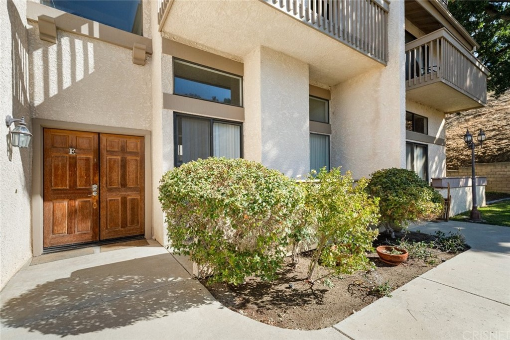 Nestled in a deep valley of Calabasas, in a non-gated community, sits a 1,374 sqft, 2-bedroom, 2.5-bathroom condominium, move in ready, with room for potential, for the next lucky buyer who brings their good share of modern taste. A paved walkway leads to a double door entry and openly welcomes you to a large multi level high ceiling condominium. Laminate flooring throughout the whole unit with tons of space in each room to fill up with tasteful furniture. Stairs that lead to the mid level of the home with a large open floor plan and a smooth transitions to the kitchen that has built in appliances. Another set of stairs that leads to the upper level hallway which has tons of cabinetry for a linen storage and connects 2 bedrooms, both of which have built in closets and en suite bathrooms. One of two bedrooms has a lengthy balcony with views of the mountains and the community tennis courts. Unit includes an attached 2 car garage on the lower level of the home with an attached laundry/dryer hookup.