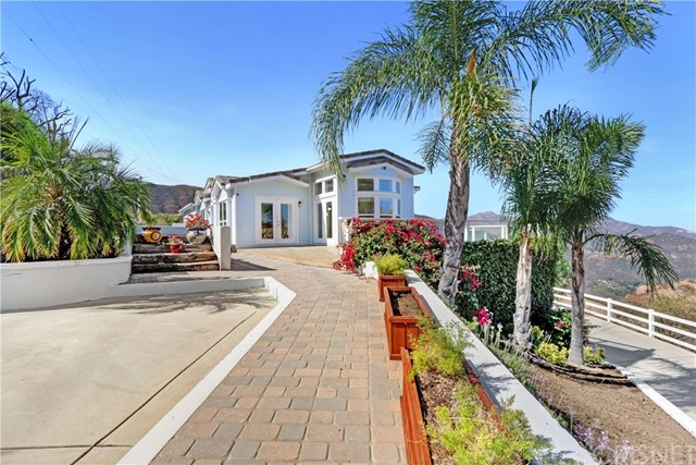 Welcome to this beautiful customized home located in Malibu, one of the most significant & prestigious residential compounds in the United States. This exceptional and unique gated home with complete privacy and explosive unobstructed panoramic mountain views with Approx. 4 acres of land has endless possibilities with extra room to add a detached garage, a huge guest house, pool & spa, tennis court, basketball /sports court, playground and much more. Interior features bright and open floor plan, over 5,000 sq. ft., 5 bedrooms,4 baths, constructed in 2002 with sensational high quality finishes throughout, spectacular resort-style outdoor sitting area with magnificent mountain views and so much more. This property can be purchased as investment with tenant in place or can be purchased as owner occupied with 60 days notice to tenant to vacate the property, call for detail