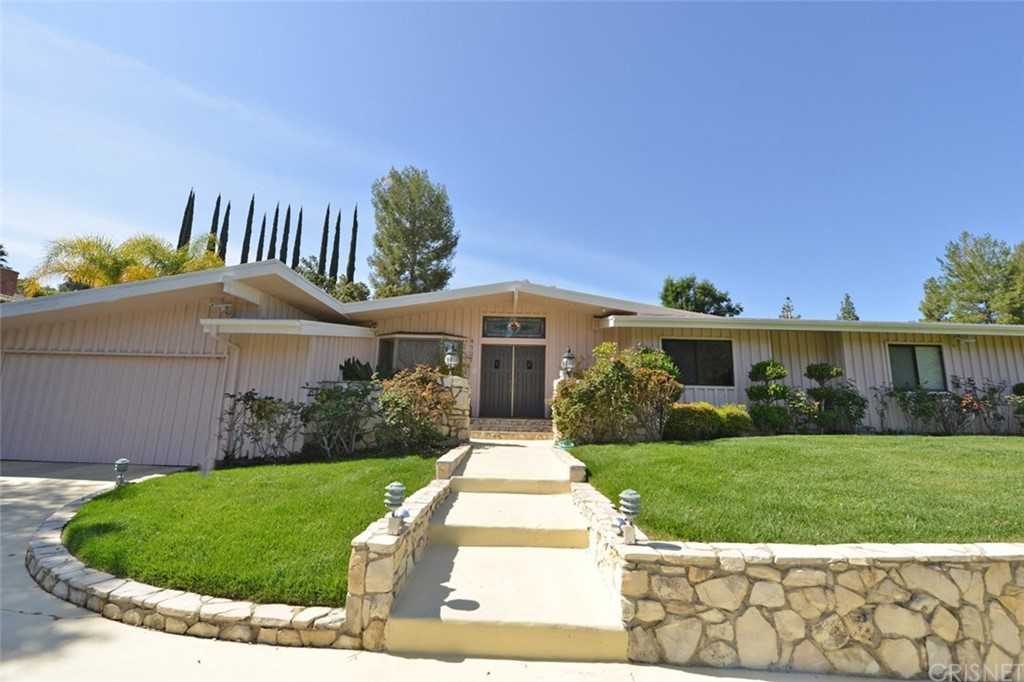 Spacious Ranch style home in a highly sought-after Tarzana neighborhood South of Ventura blvd. This well-maintained cosmetic fixer is the perfect home for that buyer looking to have privacy and security. On a fully gated and private circular driveway, plus a 3-car garage. This single-story home offers an open floor plan with cathedral beamed ceilings throughout, granite counters, custom cabinetry, recessed lighting, pecan, walnut & marble floors. Large master suite with sitting room, 2 walk-in custom closets, and bathroom with Swedish wet/dry sauna. Some additional features include wine closet, family room with fireplace & wet bar. Cozy library/bedroom with custom built in book shelves. Cooks kitchen with double confection ovens, and six burner Bosh hot top. The entertainers back yard is perfect for entertaining guests or just relaxing with two expansive patios, a sparkling pool, and complete with mature landscaping for additional privacy. Aggressively priced to sell, wont last long.