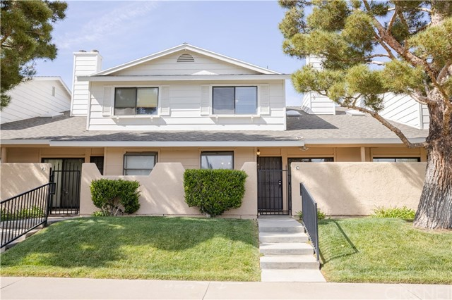 """This beautiful townhouse is back on the market and it is nestled in one Palmdale's most sought after communities, and as soon as you step inside you'll immediately recognize the true """"Pride-Of Ownership."""" Here are just a few of its many other fine features: Lush landscaping and towering shade trees enhance the complex's curb appeal. You'll step into a flowing 1,225 square foot open concept floor plan that is in """"Move-In-Condition"""" with complementary laminate flooring throughout. The spacious living room is bathed in natural light from the sliding glass door to the entertainer's patio, and has a high vaulted ceiling plus a cozy gas/wood-burning fireplace with custom hearth. The family's cook is going to truly appreciate the kitchen's large garden window, abundant cabinets, stone counters with back-splash, durable dual basin stainless steel sink, built-in appliances, large breakfast bar, plus the convenience of the adjoining dining area with lighted ceiling fan. Both bedrooms are configured as master suites with private bathrooms; One also has a lighted ceiling fan, and """"His & Her"""" mirrored closets A total of 2½ bathrooms; The ½ bath is located on the first level for your guests. Central air & heat for year-round comfort. Laundry is functionally located inside the 2 car direct access garage. You're going to enjoy the community's lush greenbelt, soothing spa, sparkling pool, and recreation room. Great location a minute away from the Antelope Valley Mall, grocery stores, restaurants, and the 14 freeway. Call us now for all the details and we'll gladly arrange a private tour."""
