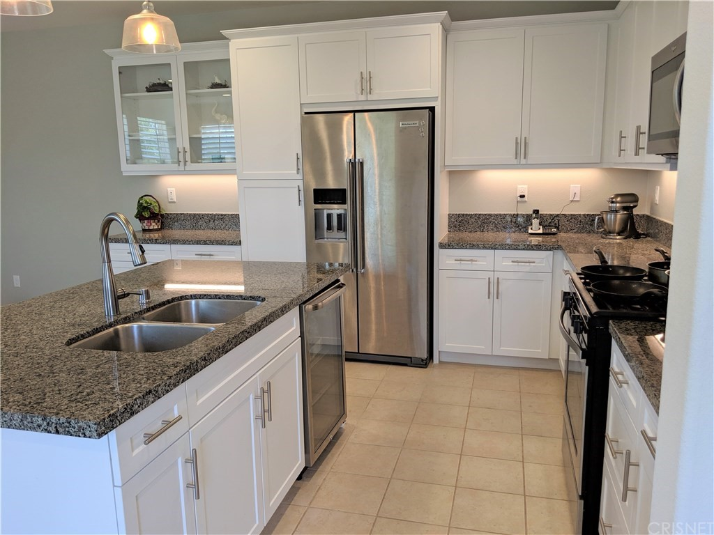 """JUST REDUCED!!! NO NEED TO WAIT FOR NEW CONSTRUCTION+ BIG SAVINGS $$$ + TOP RATED SCHOOLS WEST CREEK ACADEMY, RIO NORTE JUNIOR HIGH & VALENCIA HIGH. Beautifully upgraded townhouse with 3 bedrooms plus open loft, 2.5 baths, and a private side yard.  This the 3X model the largest of this community corner lot, only 1 shared wall with a front yard, and a great size side yard which is ready for your imagination. This Modern home offers a bright kitchen with a large island, featuring granite countertops in New Caledonia, shaker style white cabinets, Whirlpool stainless steel appliances, and a stainless steel sink. An upgraded add-on glass cabinet in the kitchen with extra recessed lights & electrical outlets. Pre-wire upgrades and modern tile floors on the first level. Light and bright home with upgraded solid basswood plantation shutters throughout. Under stairwell storage. When you're ready to retreat for the evening, head upstairs. This home features a spa-like master bath with white shaker cabinets, cultured marble countertops with a 4"""" backsplash and a large master shower. There's even a water outlet for an electric toilet. Association amenities include a pool, spa/hot tub, picnic area, playground, sport court, biking trails, and clubhouse. As part of the West Creek community, the home is near greenbelts, schools, paseos, and shopping. DON'T MISS THIS OPPORTUNITY!!"""