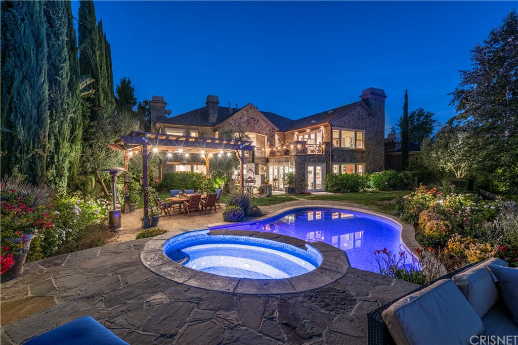 Fall in love with this One-of-a-kind New England style chateau at the top of Mont Calabasas Estate nestled high on the rolling hills of Calabasas surrounded by nature at its best with astoundingly scenic views. This beautiful traditional luxury 7,440 SQF, 6 bed, 7 bath, Cul-de-sac home, located on one of the quietest streets in this beautiful, 24-hour, only $410/month guard-gated community. This home welcomes a spacious and thoughtfully designed floor plan and is perfect for luxurious living features soaring ceilings, formal dining and living rooms, a downstairs bedroom suite, and an oversized en-suite office. Chefs' kitchen boasts stainless steel top of the line Viking appliances, 2 islands, wine refrigerator, Home Theater, & Home Gym. Master suite features a fireplace, a huge walk-in closet, an over-sized master bath with soaking jacuzzi tub, and a separate sitting room/office/workout room, opens to a private balcony overlooking the backyard and surrounding panoramic mountain view. The backyard features luxury living pool and SPA and a built-in barbecue/gazebo area lets you enjoy the peace and serenity this home has to offer! Close to parks, hiking, jogging and bike trails. Incredible must-see views throughout! Minutes from Malibu and the beach. Please see private remarks for showing instructions!!!