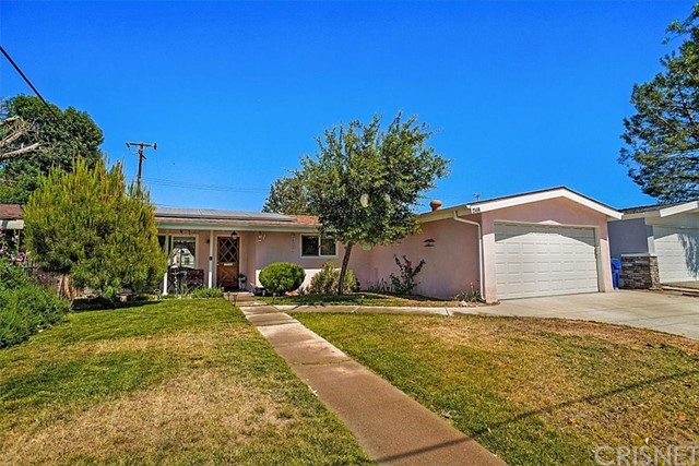 Lovely home in Canyon Country, on a 6,214 sq. ft. lot! 3 bedrooms and 1 1/2 baths. 2-car attached garage with direct access. Cement driveway! The full bath is located in the hallway and the 1/2 bath is attached to one of the bedrooms. The full bath, with shower/tub combination, has been remodeled. Many other upgrades include: Central air and forced-air heating, dual pane windows, including the sliding glass door, copper plumbing, solar panels, new electrical box/200 amp panel, new wiring, newer roof ('2012), mostly tile floors throughout, ceiling fans in every bedroom and smooth ceilings throughout. The living room with a vaulted ceiling, has a ceiling fan, tile floor, has a glass slider out to the yard and it is open to the kitchen. The kitchen includes a vaulted ceiling, an eating area, gas oven/range, built-in 2-drawer dishwasher, built-in microwave, and a door out to the covered patio and yard. Hurry, this home won't last long!