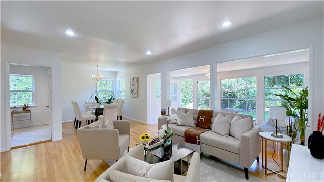 Step in to this 3 bedroom Santa Monica home (3rd bedroom has 2 entrances so can be used as office or den) and 1 bath. Recently remodeled Kitchen and Bath, granite counter tops and stainless steel appliances. Redone electrical as well (all with permits). Stackable washer/dryer included! Beautiful landscaped front yard and large open backyard with multiple fruit trees. Generous patio shaded by mature trees to provide a refreshing and protected outdoor environment. Hardwood floors throughout. Large and deep closets. Wall of windows to show off and open up to very private backyard. Eight foot hedge surrounds backyard for quiet and privacy. Plenty of street parking with permits. Bilingual Edison Elementary School nearby. Both Trader Joe's and Whole Foods 365 approximately half a mile away. Walking distance to Ishihara Park with learning garden, BBQ's, picnic tables, exercise equipment and a children play area. Just a short hop down Olympic Blvd to Santa Monica Pier. Train station and bus stops within blocks. Excellent freeway access and a quick trip to restaurants and shopping. ZoningSMR2. Unpack your bags-You're Home!