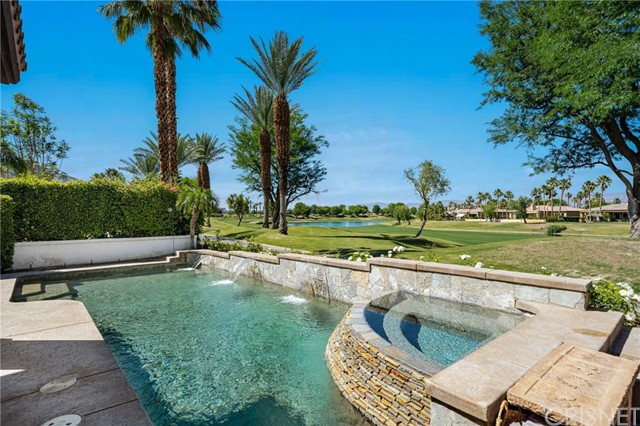 Don't miss this incredible Spanish Bay home (Popular Quevado Plan) on the 18th fairway with Lake & Mountain Views. Steps from the Tournament Clubhouse. Enter the private courtyard, which features a custom waterfall and Pergola to enjoy the view of the Santa Rosa Mountains. Once you enter this 3 bedrms,3.50 baths designer home that has been furnished with Restoration Hardware furnishings and lighting throughout the home. The formal living room features high ceilings and French doors leading to the courtyard. The cooks kitchen has granite counters and a oversize island with Viking appliances, there are also travertine floors throughout the home and recessed lighting. The family room features a stone fireplace with bi-folding doors opening to the covered patio which is perfect for entertaining indoor/ outdoor. The expansive master bedroom features a double sided fireplace and leads to the luxurious master bathroom with an oversize tub and his and hers vanity sinks. The entertainers yard features a saltwater, pebble tec pool/spa with cascading waterfall with views of both the lake and golf course.