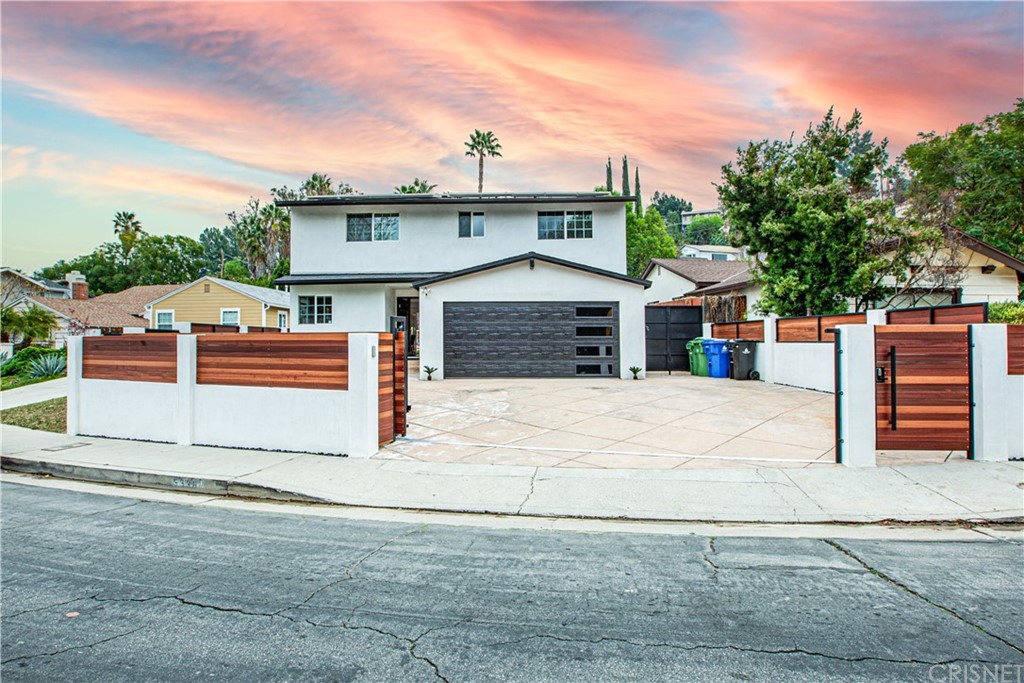 Beautiful fully remodel two story home south of the blvd. 4 bedrooms, 2 bath, master bedroom with 2 walking closets. Custom private gate, solar system (fully paid), new wood floors, new kitchen with granite counter tops and back splash with slate tiles. New remodeled bath, family room with wood burning fireplace.  copper plumbing, new ducting, newer water heater. recessed lighting, dual pane windows and sliding patio door. Great backyard with raised wood deck for entertaining and custom pool with Baja, waterfalls, under the water sitting area, slide and spa, new pool equipment with new remote. All kitchen appliances, washer and dryer and furniture are included in the sale. South of the Blvd, Fantastic location close to Topanga Cyn & Mulholland Drive, minutes from the 101 Freeway, & short drive to The Village, Warner Center Restaurants, Shops & Public Transportation. Assigned to Woodland Hills Elementary school, one of the best schools in the area.