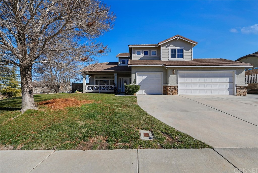 Beautiful corner lot home, located in a desirable quiet residential street. This great home has high ceilings, formal dining, and living room areas as well as a large family room with a fireplace. The kitchen has granite countertops and a kitchen island. There are a downstairs bedroom and a full bathroom as well as a bonus room. Upstairs there is the Master Bedroom with a large deck, perfect to sit and relax and glaze the far mountains and the starry sky. The master bathroom has a separate shower and tub as well as double sinks and a large walking closet. Also upstairs there are two other guest rooms and a hall full bathroom. The backyard is large, with a built-in barbeque area, stamped concrete and on the side, there is plenty of space for a large RV. Wood laminate and Tile floors throughout. The home was recently appraised way above listing price. Excellent opportunity for instant equity.