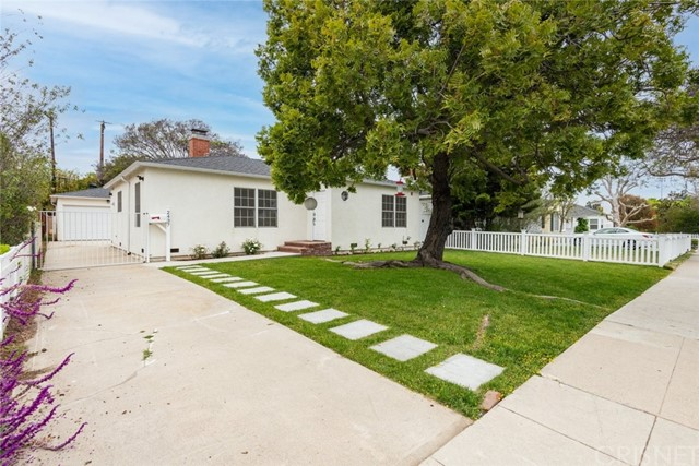 """A charming family home nestled in the coveted city of Santa Monica! This is a 3 bedroom, 1 bathroom home that was remodeled/rebuilt in 2017. Set upon a huge lot with a neat front lawn and prominent trees framing the exterior, enter a home filled with beautiful natural light streaming throughout. Delight in gorgeous hardwood floors installed in each room and a darling entryway stylized with the phrase """"love"""" built into the glossy wood. A spacious living room featuring a cozy fireplace and adjoining dining room includes large French windows, all over accent moldings, and ceiling light fixtures. Join the built-in stainless-steel appliances, ample cabinetry, and stone countertops of the kitchen to partake in crafting culinary creations and an adjacent laundry area with backyard access. Each spacious bedroom in this 1,142-sqft abode enjoys large built-in closets with one room housing a set of double doors leading out to the backyard. Outside is an open patio with decking and an expansive back lawn that's perfect for any outdoor gathering. Plus, the property includes a detached 2-car garage that can be great for an ADU. Located near Clover Park, Starbucks, Penmar Park, schools, and popular dining!"""