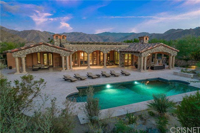 If you ever wanted to live in Italy, here's your chance. This beautiful custom home in THE RESERVE is like no other. Completed in 2011, this approx. 5,450 sq.ft home with approx. 34,000+ sq.ft. lot could be yours. Also, enjoy the one bedroom guest house w/own washer and dryer, tankless water heater-also in main house. You'll be delighted to see the custom cabinets by Francis and Wane and the kitchen featuring Northland stainless interior refrigerator and freezer with kitchen range by CornuFe by LaCornue. Also, there's a GE Advantium multi purpose oven in kitchen island. Butler's pantry w/slat wall storage, sink, dishwasher, drawer refrigerator & microwave. Calcutta Oro marble on kitchen island and in both master baths. Her master bath is designed by Barbara Barry and Kallista. His and Hers separate bathrooms with walk in closets. Three zone high efficient a/c in main house, smart home technology, 6 fireplaces and Venetian Murano light fixtures. Large central courtyard with two antique fountains. Enjoy the covered outdoor entertainment area of approx.3,000 sq. ft., the pebble tec pool, spa, gas firepit, solar, and outdoor kitchen w/Lynx BBQ and refrigerator. Full wired alarm system plus security cameras. 3 full garages and one golf cart garage. Surrounded by glorious mountains.