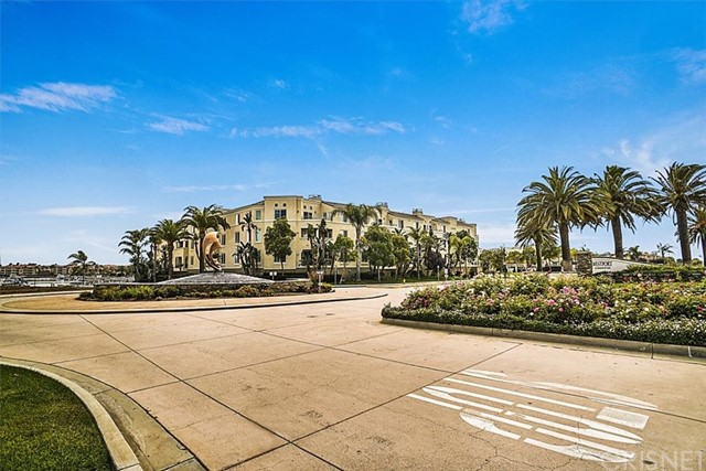 Move-in Ready Luxury Condo on Channel Islands Harbor.  Easy Access to all that Sea Bridge has to offer.  Open Floor Plan with Gourmet Kitchen - Granite Counter Tops, Stainless Steel Appliances ( Refrigerator Included), Center Island and lots of Cabinets. Wood Laminate & Tile Flooring in most rooms.   Dining Area and Family Adjoining with Warm Fireplace and Balcony with view of the Channel.  Dual Master Suites - one with walk-in closet and access to Balcony. Inside Laundry Closet with Stackable Washer/Dryer ( Included), Powder Room near Entry.  Two spaces in Subterranean Garage plus Storage Units.