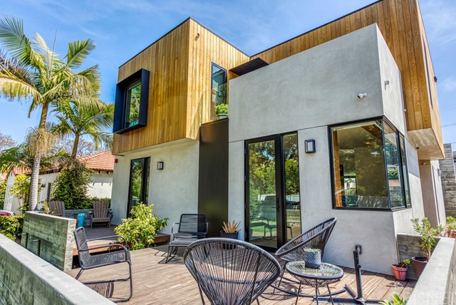 """Welcome to Kansas, an award winning family home on a quiet cul-de-sac in Sunset Park of Santa Monica. Completed in 2020 by Farnsworth Builders and designed by AAHA Studio. """"Best of La Cantina 2020"""" award winner and submitted for the prestigious AIA Award. This contemporary residence is defined by large volumes strategically offset to create entry points, outdoor terraces, and shading throughout the day. A floating full-length boardwalk draws you through to the side/main entrance surrounded by lush new landscaping. The main living space with entertainers kitchen, is anchored by a 22' wide sliding glass pocket door for that indoor/outdoor living experience. Polished concrete floor runs continuously from the kitchen through the back yard with the door track surgically embedded into the slab. The home is layered with custom fabricated, warm walnut millwork deliberately set against the cool of the poured concrete floors. Wide-plank oak floors provide a tonal contrast at the entry level, upper level bedrooms, staircase and hallways. Oak cabinetry accents in bathrooms offset by full length, gray marble slabs. Ample storage was provided wherever space allowed to ensure that the contents of family life can be tucked away. Detached garage with modern EV charging and alley access, make for a simple ADU conversion. With a fabulous walkable score and close to the trendiest restaurants, shops, parks and freeway access, make Kansas a very attractive purchase."""