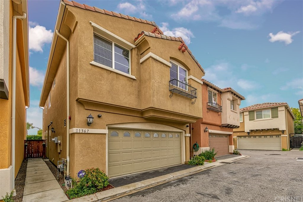 This amazing 2011 built detached and exceptionally well-cared home with NO HOA is an opportunity that does not come very often.  This home offers a beautiful kitchen with dark wood cabinets, granite counter tops and stainless steel appliances which are all included; an open living room, dining room with upgraded tile wood grain look floors throughout. As you  head  upstairs you get to appreciate the stylishly wrought iron stairway to land on the second floor where you will  find the loft area with plenty of light coming from the skylights 3 good size  bedrooms and a full  bathroom ;  Then as you enter through the custom arch doors  you  find a beautiful Master suite with a large walking closet and an upgraded master bathroom with double sinks and granite countertops. The home living room area is wired for speakers and exterior security cameras are included. There is a 2 car garage with a laundry area and as a bonus, the washer and dryer are included too. The outdoors offer a nice private patio and automatic humidity sensitive sprinklers. The solar panels are currently leased for under $50.00 a month. There is plenty of guest parking and no Mello Roos fees.  Centrally located within minutes to the Discovery Cube & Hansel Dam Recreational area and very easy access to the 210, 5 and 118 freeways for your commute.   This home is a dream come through, so don't walk, but run to check out this incredible model perfect looking home, before it is gone.