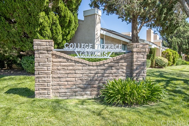 Rare College Terrace Garden Townhome. Located in a highly desired West Lancaster area, walking distance to the Antelope Valley College. This model is the largest unit in the community. This beautiful town home has 2 bedrooms downstairs, 1 large master suite upstairs & a bonus room which is currently being used as a 4th bedroom. The property has 2 bathrooms, 1 downstairs and 1 upstairs. The property has high vaulted ceilings in the main entry and living room, with hard wood floors throughout the downstairs living area, and a cute loft upstairs. The property has a large enclosed patio approximately 450 sq. ft. which is in addition to the 2316 sq. ft. living space. The property has indoor laundry, attached 2 car garage, and a community pool next to large lush park like grounds. This property has so many upgrades you have to view it.