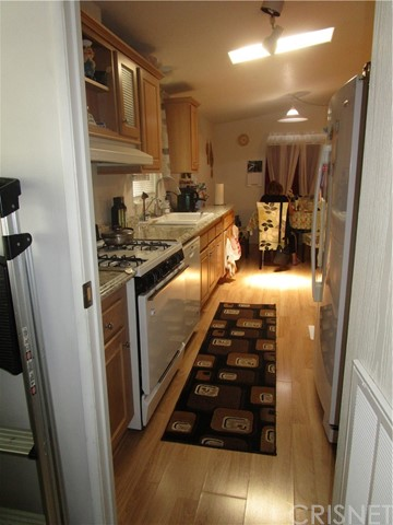Beautifully appointed Kitchen with Skylight includes appliances