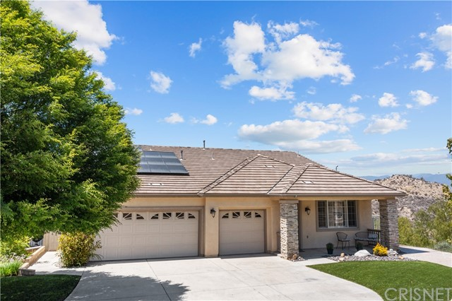 Single story end of Cul-de-sac house with a dramatic view lot over looking the valley and Castaic lake.  Wonderful views from kitchen, breakfast nook and family room. 3 Bedroom and 2.5 baths in the large one story house with a great open floor plan.  The Seller has converted the front living room and dining area into two large home offices.  Kitchen open to the great room has quartz counter tops with stainless steel appliances with a farm sink and island. Very large master bedroom at the rear of the house with sliders to the backyard with a view of the valley. Large open master bath with separate shower and tub attached to a large master closet.  Oak floors through most of the house and new carpet in the two other bedrooms.   Private backyard has a patio cover and great views.  There is a long driveway with RV hookup -plenty of room for vehicles and a full three car a garage.   Several homes close to this Cul de sac have sold for over a million dollars.  Solar is owned and is free and clear sold with the house. No Mello Roos or HOA fees.