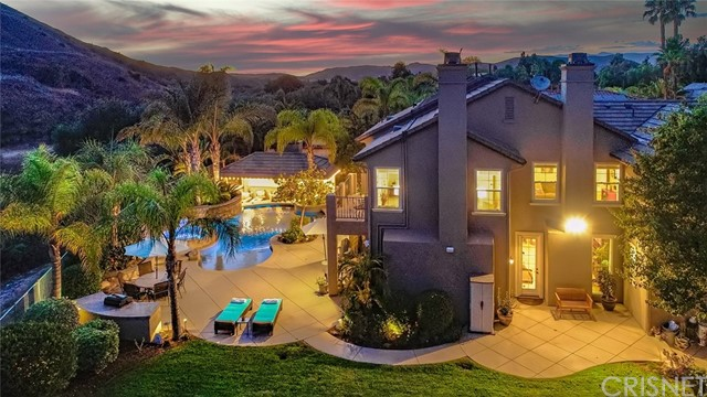 Fall in love with this luxurious 5 bedroom, 4.5 bath, 2 offices, 4 car garage home in the prestigious Northgate enclave. Expansive 14,855 sqft cul-de-sac lot with unobstructed views. Every day will feel like a vacation in your own home! Sweeping hillside views, incredible privacy, stunning sunsets and the extravagant RESORT STYLE backyard will take your breath away. This home features a spectacular PebbleTec pool/spa with spacious Baja shelf, swimming ledges, waterfalls and an amazing SWIM-UP BAR at your own POOLSIDE SUNKEN CABANA. Easy outdoor entertaining with built-in BBQ, shaded cabana living room, television and bar area, outdoor speakers, spacious lawn area for playing games or simply cozy up next to the stone fireplace and hearth. Relax and enjoy lush tropical landscaping, beautiful hardscape and nighttime landscape/pool lighting. You might catch glimpses of horses on the nearby trails! INSIDE, you will undoubtedly notice the EXTENSIVE UPGRADES and pride of ownership as you enjoy the open floorplan and easy flow of this lovely home. Tumbled travertine flooring, wood shutters, crown moldings, abundant custom built-in cabinetry, 9' ceilings, 2 fireplaces, surround sound, alarm system, smart home features and more!  The GOURMET KITCHEN opens to the family room and boasts granite counters, generous cabinet space, a large walk-in pantry, TWO SINKS including separate prep sink, dual ovens/convection, 5 burner gas cooktop, and a grand center island next to the casual dining area.  Main level living also features a GUEST SUITE with a private full bath, SEPARATE OFFICE with dual custom desks/cabinets and French doors to an outdoor patio. The dining and living rooms each have separate access to outdoor patios. UPSTAIRS, there are 4 En Suite bedrooms, including the master bedroom which also has a sitting area and a balcony. This magnificent owners suite spans the back of the house for COMPLETE PRIVACY. SPA-like owners bathroom with vanity and dual sinks, oversized walk 