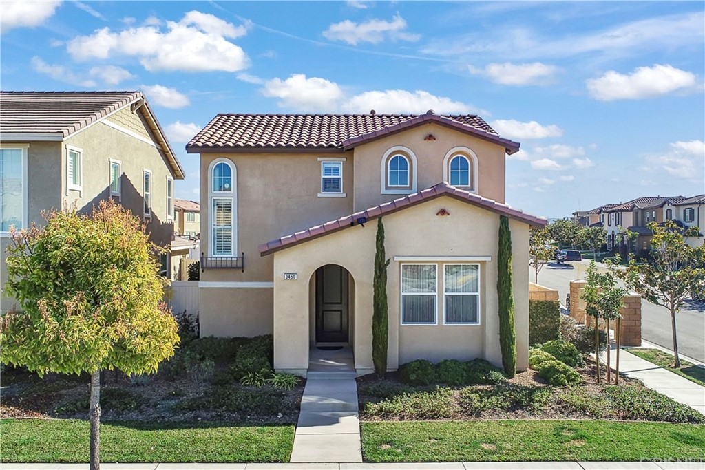 """Welcome to 3450 N. Oxnard Blvd. This former Riverpark single-family home has WAY to many upgrades to list. It features 4 bedrooms, 3 bathrooms, with 1,987 sq. ft. of living space. The large open floor plan comes with a main floor bedroom and bathroom, a huge family room with built-in and custom window coverings plus stunning wood floors. The kitchen has granite counters with backsplash, kitchen hardware, stainless steel appliances with included refrigerator, reverse osmosis & soft water systems, and pendant lighting. The slider opens to a large corner lot with lots of privacy. The large master bedroom features crown molding, accent walls, plantation shutters and custom light fixtures. The master bath is spacious with quartz countertops, an upgraded tile shower, and a walk-in closet. Also on the second level are two additional bedrooms with custom accent walls, crown molding, window coverings, and upgraded light fixtures. There is an additional guest bathroom plus a laundry room that includes the washer and dryer. Stay cool with A/C and use it as much as you want with the Tesla Solar System. The Riverpark community is conveniently located near new schools, walking trails, several parks, barbecue areas, gazebo, fountains, basketball courts, and tennis courts. Enjoy a short stroll to the recently developed """"Collection"""" with the Century Theaters, Target, Whole Foods, and Yardhouse. Easy access to 101 freeway. In Riverpark, you're not just buying a home, you're buying a lifestyle."""