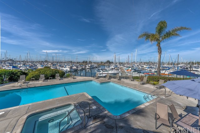 Beautiful Marina view condo in the Channel Islands beach area. This home has been upgraded throughout and has excellent west facing light and great views. The Kitchen has granite counters, custom cabinets and stainless steel appliances. Bathroom has been upgraded with frame less glass shower and custom tile throughout. Recent upgrades within last couple of years include new refrigerator, dishwasher, stove top, new blinds in living room and bedroom, bathroom tile, paint in all rooms,and double front door locks.New luxury plank vinyl floors just installed throughout home. Enjoy the association amenities clubhouse with pool, spa, saunas, gym, barbecues, lounges and tennis courts. Enjoy the sunsets on the spacious patio with incredible views of the main channel and pool area. Secure parking and single level living at it's best.