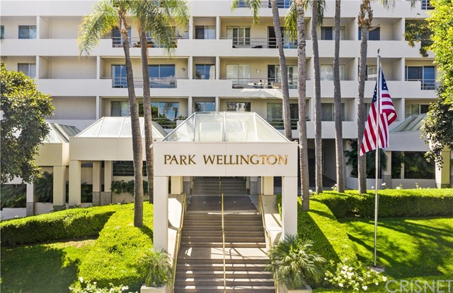Welcome to this elegant and stylish condo in Park Wellington. This resort style complex offers 24 hour security, front desk doormen, heated salt water pool with two spas, tennis court, newly remodeled fitness center, sauna, dog park and gated parking garage with guest parking. Enjoy this beautifully updated open concept layout with gleaming wood floors, granite counters, stainless steel appliances, custom closets, private patio and updated baths. Close to some of the finest restaurants, hotels and shops that Sunset Boulevard has to offer.