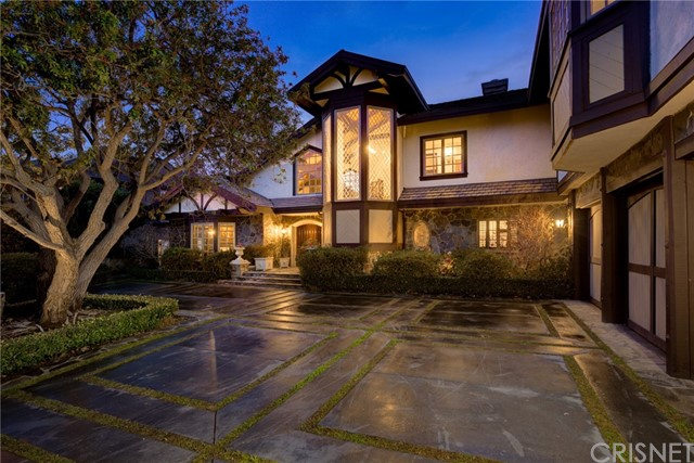 Incredible investment opportunity! Located in the prestigious, guard-gated community, The Summit in Beverly Hills. This Tudor style home offers luxury and convenience with quality and detail to impress. The floor plan is flooded with natural light and offers astonishing 280 degreemountain, city light and ocean views. The newly renovated Chef's Kitchen is fitted with Viking appliances, dual Sub-Zero refrigerators, dual double ovens, extensive counter space, and a walk-in pantry. Each of the five spacious Guest Bedrooms have updated en-suite bathrooms. One extra large Guest Suite offers its own separate entrance and private living space,perfect for visitingguests or extended family. The Master Bedroom Suite has some of the best views in the home, tall vaulted ceilings, dual walk-in closets, fireplace, stunning Carrera marble shower, separate soaking tub and dry sauna. The estate grounds feature an infinity edge pool with jaw-dropping views, outdoor gourmet kitchen plus a grassy lawn with plenty of room to play. Other noted features include a rare, underground Wine Cellar and tasting room to showcase your best vintages, extensive storage in each bedroom and throughout the home, a backup emergency generator and 3-Car garage. Perched at the top of Mulholland Drive, and nestled in a quiet cul-de-sac, this gated estate offers incredible privacy with convenient access to all city and valley destinations just a short distance away.