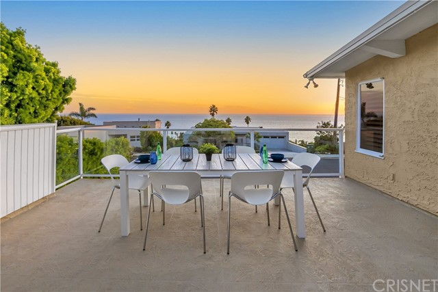 """Here is your chance to live the Malibu Lifestyle you've always wanted! Nestled on a peaceful cul-de-sac, this light and airy 5 bedroom/4 bath home offers  stunning coastal views and is located over the iconic beach made famous in the Beach Boys song, """"Surfin' USA"""".   Situated on over half an acre, this Malibu home offers privacy, gorgeous views and ocean breezes.  As you enter, you are greeted by a large great room with a cozy wood burning fireplace.  The updated kitchen offers granite counters, glass front cabinets, Thermador double ovens and a Viking range. Hear the surf as you fall asleep in the Master Suite with tranquil water views and an updated Master bath featuring a cedar lined closet, spa like glass enclosed shower, dual sinks and a beautiful sky light letting all the sunshine in.  Opening the French Doors from the Master you enter the enticing spacious deck where you can watch the colorful sunset skies over the Pacific. Enjoy two more verandas perfect for outdoor dining, stargazing or just having coffee. Enjoy the fenced yard with fruit and flowering trees.  Close to the classic eatery, Neptune's Net, the luxury Marisol development, some of Malibu's best beaches  and the upscale dining and shopping of Trancas Country Market."""
