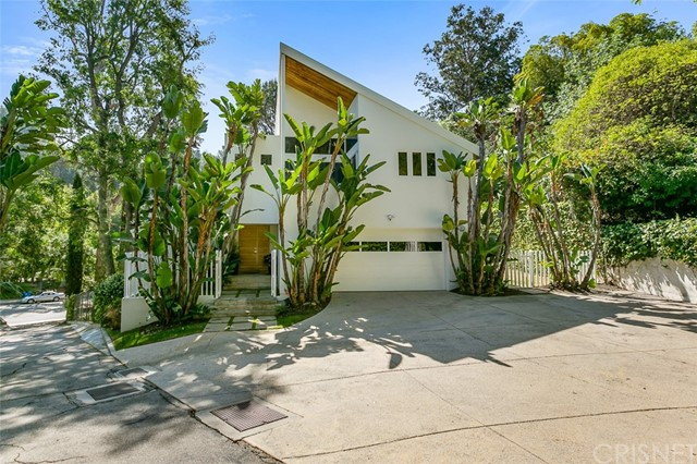 The 4 bedroom 3.5 bath architectural Bel Air Retreat is surrounded by lush green landscape. The pool estate embraces the indoor outdoor Southern California Lifestyle. The retreat is the perfect blend of understated elegance and impeccable Craftsmanship highlighted by Amazing Voluminous rooms, a sun drenched open floor plan and floor to ceiling windows, hardwood Floors, soaring ceilings and granite counters in the kitchen, large Loft and Library. The immense bright master suite is a world of its own with a private balcony sitting area , fireplace and high ceilings. The master bath features marble counters, high ceilings and a steam shower. The 45-foot swimmer's pool with active solar thermal heating system nestles in the yard and is juxtaposed against a sunny deck replete with a Jacuzzi, fire pit, and built-in bbq. State-of-the-art amenities include app-controlled thermostat, new AC and heating units, Large hot water heater and Tesla high-speed charger. The yard is large private and big enough to possibly add an ADU.  This serene home is perfect for intimate dinner parties or all-out bashes and the entertaining continues though seven pairs of custom French doors to beautiful patios, wrap-around decks, a large verdant landscape filled with towering redwood, pine, eucalyptus and palm trees. Combining the ultimate in privacy, quality and style, this property exemplifies the relaxed Bel Air lifestyle. The house sits off of Beverly Glen and is accessed by a shared driveway leading to a large parking area in front of the two car garage. The location is close to the Glen center with Shops Restaurants and a Jazz Club. The position of the Retreat provides easy access to Beverly Hills, the westside, the valley, and freeways.