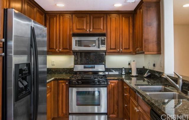 Beautiful Kitchen with Granite and Stainless Appliances