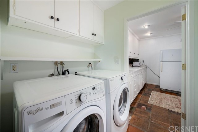 Inside Laundry area with lots of cabinets.
