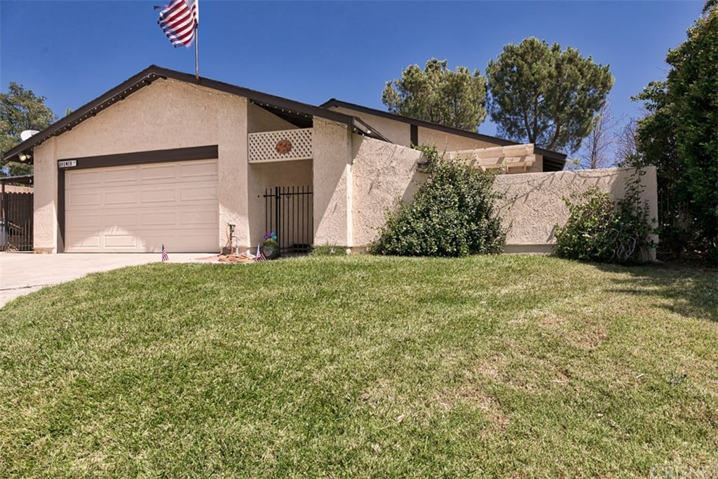 Great single story home with 3 bedrooms, 2 full baths, open layout, that includes a living room, dining area and a family room with a wood burning fireplace. This home is located at the end of a cul-de-sac and offers a private backyard with a covered patio and possible lake views. This home has natural stone floors throughout and carpet at the bedrooms. This single story home is a perfect place for the outdoors enthusiast which is in need of a large RV space, and as a bonus, it has a boat covered parking in addition to an attached 2 car garage. Easy freeway access and minutes to Castaic Lake. This home has too much to offer and at this price, you won't be disappointed.