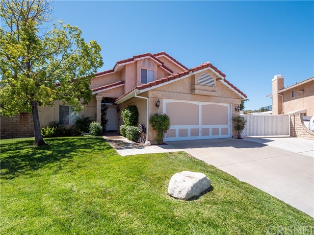 Welcome to this updated turnkey 4+3 open concept pool home on a prime lot that is over 11,000 sq ft. Located on a cul-de-sac w/RV parking, Bed & Bath downstairs, No HOA No Mello-Roos! Step into your new home and enjoy all the new bells and whistles, like the gorgeous new flooring throughout,  recessed lighting and the beautiful modern stair railing. Spacious light and bright living room with high ceilings that opens to the formal dining area. NEW kitchen with stainless steel appliances featuring a dual-zone oven, quartz countertops, concrete sink and fixtures. Tons of storage and counter space, breakfast bar, breakfast nook, opens to the cozy family room with a brick fireplace. Downstairs bedroom and a full bathroom. Head upstairs to your Master bedroom which features high ceiling, updated bathroom and dual sinks. Two additional bedrooms and full bathroom. Stepping outside reveals your private yard perfect for entertaining, featuring a covered patio, built-in grill, lighted horseshoe pit, pool and spa. All this conveniently located near the 5 freeway, shopping, schools, restaurants and more!!