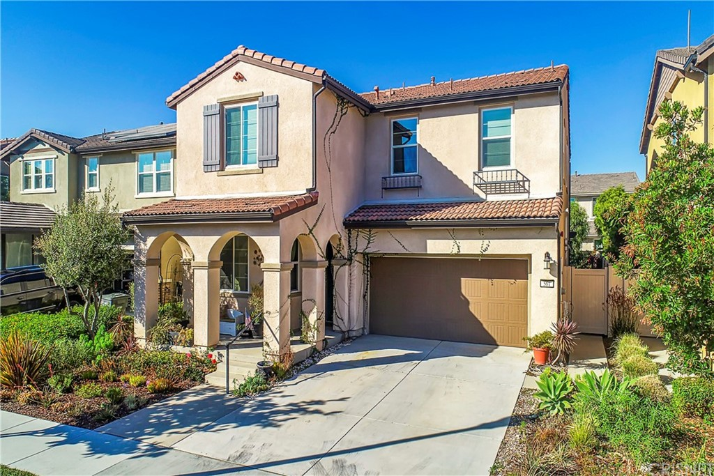 You'll absolutely love this stunning, former model, single-family home with over $290k in builder upgrades. A rare, 5 bedroom plus loft, 3 bath two-story home with 2377 sq. ft. Large, free-flowing floor plan with gorgeous tile floors. The main floor of this home features a large bedroom and full bath, a huge family room (both with ceiling fans) dining room, oversized kitchen with Caesarstone quartz countertops, custom backsplash, maple cabinets with hardware, GE stainless steel appliances, walk-in pantry, kitchen island with pendant lighting and bar seating. Don't miss the Maple wood and wrought iron staircase before you head upstairs. The upper level features 4 large bedrooms, a huge loft (all with ceiling fans) plus a large laundry room with extensive cabinetry and wash sink. The oversized master with custom en-suite 5 piece bathroom, dual sinks, beautifully tiled walk-in shower, separate soaker tub also features a walk-in closet. Look for the custom blinds throughout with room darkening features in bedrooms and retractable front screen door, additionally added by owners.  Attached 2 car garage with owner-upgraded ceiling storage racks and driveway. The large backyard has beautiful, mature landscaping providing all-around privacy, stamped concrete entertaining space, and pergola. Stay cool on warm days with your central A/C with individual floor-level controls. The Riverpark community is conveniently located near new schools, walking trails, several parks, barbecue areas, gazebo, fountains, basketball, and tennis courts! All less than a mile to The Collections and easy access to the 101 freeway. You're not just getting a home, you're getting a new lifestyle.