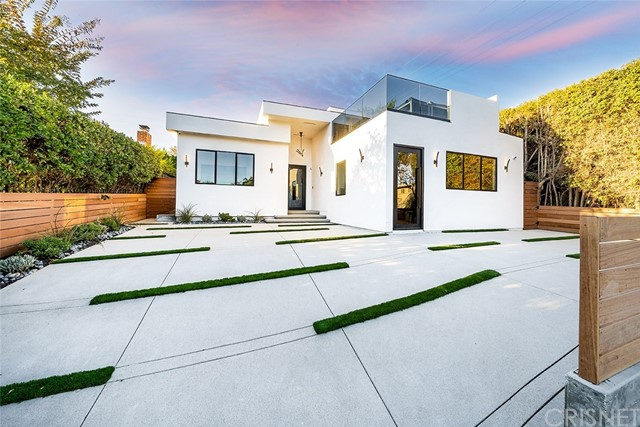 EASY TO SHOW VIA ZOOM, FACETIME, or VIDEO, through SOCIAL DISTANCING! Gated and gorgeous modern architectural showpiece in coveted Brentwood Glen area! Recently remodeled & updated throughout, the open concept is highlighted with high-end amenities, elegant fixtures, hardwood flooring, and designer touches. This zen-like, one-level home features high ceilings, temperature-controlled wine room, stunning chef's kitchen with custom designed island, quartz counters, sleek cabinetry, 6-burner stove, and dual ovens. The calming master suite includes a spa-like bath, gorgeous detailing, generous walk-in closet, and direct access to the lush backyard. 5th Bedroom enjoys an ensuite bath + kitchenette, so it can be closed off as an ADU w/ it's own private entrance for blended family or rental income, if desired. Enjoy a spacious laundry room. Entertain or relax on your fabulous roof-top sundeck w/ Great Views + flat screen hookup for those lazy Sunday mornings, or those kick-back evenings w/ friends & family. Easy breezy backyard offers full privacy, patio, grassy area, and modern built in BBQ. This home has it ALL! Fantastic location for easy access to freeway, Sepulveda Blvd., fine dining, shopping, entertainment, and houses of worship. Located in the highly-rated Kenter Canyon Elementary School district.