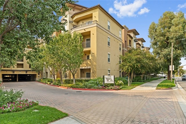 In the heart of Santa Clarita, across major shopping centers and all sorts of entertainment, sits a 1540 sqft, 3-bedroom, 2-bathroom condominium, located in a clean and well maintained complex. Upon entering this corner unit, you are greeted with tons of natural lighting that floods the open floor plan of the living room. Instantly at the left of entrance, is a lengthy kitchen, with tile flooring, styled with chestnut toned cabinetry, taupe countertops and built-in stainless-steel appliances. One hallway on the right of entry that leads to the primary bedroom and features carpet flooring, a an suite bathroom, and a walk-in closet. A second hallway that leads to two bedrooms, both of which have built in closet and carpet flooring throughout. A bathroom that has access from the hallway and  to one of 2 bedrooms, which is conveniently used for guest as well. A balcony with access from both the living room and the primary bedroom to enjoy the peekaboo view of the city lights and to enjoy cool breeze of Santa Claritas hot days. Unit includes an induvial laundry room with a washer/dryer hookup and a controlled entrance parking structure with 2 side by side parking spaces.