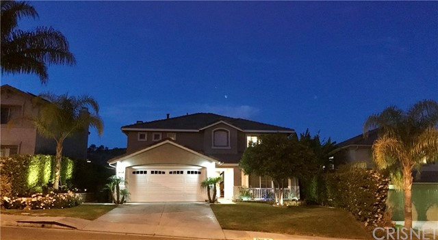 Stunning view home in the highly desirable Double C Ranch community. No HOA or Mello Roos.  Turnkey and ready for you to make it your home! This bright and open floor plan offers plenty of space inside and out. Nicely upgraded home includes crown molding & custom-made plantation shutters throughout, recessed lighting with dimmers, travertine tile, hardwood & carpet floors.  A huge remodeled kitchen comes with custom stone countertops, a large center island, and plenty of cabinet space. A lovely and spacious family room comes with a built-in entertainment center, surround sound, built-in dry bar, and cozy gas fireplace with nice big mantel.  The large master bedroom includes an upgraded bathroom with dual sinks, a glass shower with a separate bathtub, and mirrored walk-in closet.  Ceiling fans in almost every room.  The kitchens sliding glass door leads to a nicely landscaped backyard, large covered patio, storage shed, built-in gas BBQ, relaxing firepit, and fantastic view.  No rear neighbors. Close to the beautiful Castaic Lake, Aquatic Center, and more! True pride of ownership home!  Hurry don't miss this great opportunity.