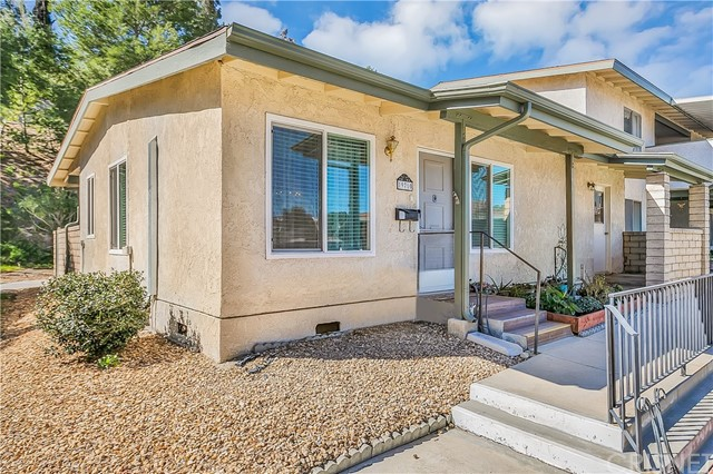 Fantastic opportunity to live in the gated 55+ community of Friendly Valley! Enjoy all of the amenities this senior living community has to offer, including a private golf course, clubhouse and pool. Great location on the corner, with only one shared wall. Large, private patio. This home offers 1 bedroom, plus a den (could be converted to a bedroom) and 2 baths. Added closet in main bedroom. Crown molding in living room and beautiful wood laminate floors throughout. Two mini split A/C units added for energy efficiency. Tour today this one won't last!