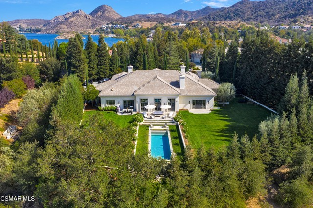Spectacular sought after single story home located on a premiere cul-de-sac street within the guard gated community of Sherwood Country Club! Recently Updated with a chic and sophisticated vibe, this absolutely incredible private estate is set upon 1.22 flat acres, and surrounded by some of the most pristine natural settings in all of Southern California. The approx. 6,100 sq.ft. floor plan features 4 bedrooms with 4.5 baths and is highlighted by a luxurious Primary Suite, a spacious Family/Great Room with bar, Office with fireplace, Formal Dining Room, and a gourmet kitchen with sunlit breakfast room. Surrounded by the stunning Santa Monica Mountains and pastoral Hidden Valley, the expansive yard and grounds boast a pool and fire-pit, mature landscape, soaring trees and enormous lawns! This is a special estate with a magical setting! Lake Sherwood is near some of the finest public and private schools in the United States. Sherwood Country Club is a short drive to & from Camarillo Airport and Malibu Beach. Additional membership to Sherwood Country Club provides amenities such as fine dining, golf, tennis, pool, spa & gym facilities.