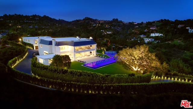 One of the most private and secured estates in Beverly Hills 90210 with stunning mountain views. The newly rebuilt & expanded Wallingford estate is spread over a 5-acre exclusive promontory. A one-of-a-kind indoor sports complex w/ basketball, pickleball, gym, boxing ring, sports lounge & bar all celebrate an active lifestyle & the love of sports. Located just 8 minutes from the BH Hotel & 20 minutes from Van Nuys private airport, both entrances can only be accessed through private/gated streets. Exquisitely designed & built w/ impeccable taste, the sophisticated & stylish estate infuses today's technology w/ magnificently refined rooms. Totaling approx. 46K SF under roof & approx. 38K SF under A/C & boosting 12 bedrooms & 24 bath, approx. 5K SF guest penthouse, caretaker house, 2-bdrm guardhouse, 10 car garage & parking for 80. The biggest zero edge pool in BH perfectly frames the extensive grounds & views. Additional property on private street also available separately.