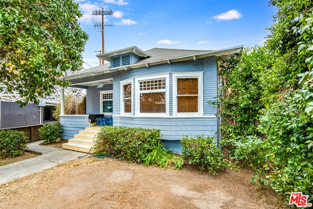 Circa 1914 craftsman style bungalow home just east of Lincoln Boulevard in Venice.  The property features a large open dining room/living room with wood floors, coved ceilings, and a built-in hutch. Large, eat-in kitchen opens from the dining room.  Three bedrooms and two baths.  The house needs work but still retains much of the original period features and charm like coved ceilings and built in cabinets.  Large back yard with parking off the rear alley.  Huge producing grapefruit tree in the front yard.   The lot is zoned RD1.5 and is just under 4,300 square feet in size.  It is bounded by two alleys making it an easy site to develop.