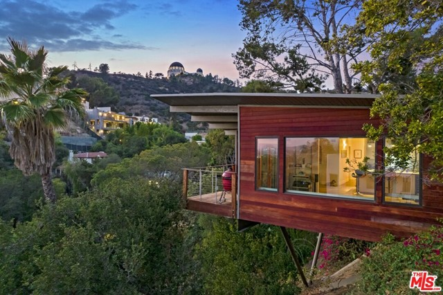 Want to live in the coveted Los Feliz Hills for under $2M? Come fall in love with the views from this 1961 Mid-Century Modern post-and-beam. An easy drive up Catalina takes you from a neighborhood full of shops and restaurants, past some of the most beautiful Spanish Colonial estates in LA, and right to this sweet 2 Bed 2 Bath with a side yard. On clear days, you can see all the way to the Pacific; every night, you can fall asleep looking out at the city lights. Whats more, the home is perched right under the Griffith Park Observatory -- each window offers a different and dramatic view of this iconic LA landmark.Recently reimagined with smart, modern features that take nothing away from its bold, captivating architecture, the home is ideal for those that enjoy walking and hiking through Griffith Park. Two entrances are within short distance, and the Observatory itself is only 20 minutes away on foot. The current owners regularly walk to dining on Hillhurst and Vermont, and appreciate the close-knit, community feel of one of LAs most stunning hilltop neighborhoods.The property includes off-street parking for three cars, dual-paned casement windows throughout, and potential to add value in the side yard (pool, ADU, deck). This is not one to be missed!