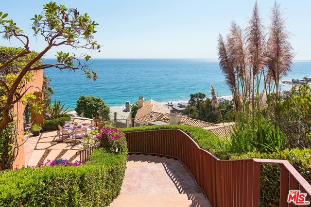 A whale of a view, and dolphins too, from this extraordinary setting in the La Costa area of Malibu. From the Queen's Necklace to Pt Dume, the ocean views captivate your senses. The garden entry flows seamlessly to the courtyard patio with inviting outdoor dining areas.This three bedroom home designed by Ron Goldman boasts high ceilings, large picture windows, and a spacious open floor plan conducive to easy living. The cook's kitchen features a large island, walk in pantry and breakfast bar. In addition to the bedrooms, there is a cozy den and a second level bonus room which is comprised of two built-in work stations with a lounge area and fireplace for relaxation.The master bedroom is an amazing two room suite with windows on the world. Wander through the home and meander through the gardens to understand the uniqueness of this location. The La Costa Beach and Tennis Club membership is available.