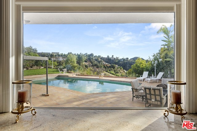 Great opportunity in prime BHPO to customize this light-filled mid-century w/ stunning views.  An open, sun-drenched floor plan w/ high ceilings & great flow for formal or informal entertaining, where the kitchen opens to the breakfast room, family room & dining room, all opening to the huge backyard w/ seemingly endless views.  Sitting at the end of a quiet cul-de-sac w/ 4 bedrooms & 3.5 bathrooms, two large living areas, a step down bar, formal yet open dining room flooded w/ natural light.  The main suite also has direct access to the backyard & views.  Great indoor/outdoor flow w/ walls of glass leading to the pool, grass area & large hardscape patio for grand-scale entertaining.  Just moments from the heart of Beverly Hills, the best of the valley & the great restaurants & shops at the Glen Centre, in coveted Warner Avenue Elementary.