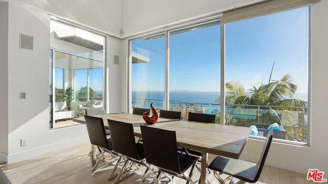 Clean, fresh, and bright modern house meets Malibu ocean views. This home boasts three bedrooms and two-and-a-half baths in the main house and a one-bedroom, a one-bath detached guesthouse with a kitchenette. On the main level, you are met with a modern open living room, dining room, and kitchen with stainless steel appliances, and panoramic ocean views from inside. Large pocket sliding glass doors, in the living room, lead you to indoor and outdoor living space with a fireplace and, featuring a spacious open front patio with 180-degree ocean views. The back patio featuring more outdoor dining space with a barbecue along, prep station and sink make this house perfect for entertaining. Steps lead you to another oasis on the property, the dual-level one bed and one bath guest house, also with ocean views which includes a living area and kitchenette. Located on a cul-de-sac provides you with a quiet and private home. Home Owner can also acquire membership to The La Costa Beach club.
