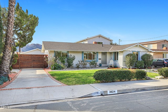 Located on a favorite street in North La Crescenta is a mid-century updated home that's ready to move in!    You'll love the curb appeal along with the privacy of your patio & backyard!  Did I mention the views?  Yes you'll relax taking in the city, mountain and views of the Verdugo Hills.  A formal entry starts the vibe of this stylish home.  The living room boasts airy high ceilings and leads to the spacious family room and home office room.  The updated kitchen has plenty of cabinets, granite countertops and appliances are included.  The master suite features an updated full bath.  Upstairs is a guest room and a large media room, office or play area. Other amenities include copper plumbing, updated electrical, lighting, central air & heating, fresh paint and newer windows.  The two car garage is at the back of the lot behind a gated driveway.  The garage is finished with insulation and plumbing.  The yard also features a newer drainage system.  This home is perfectly located in a highly desirable school district and is close to local hiking trails and parks.  Up here you feel away from it all but you're only minutes to a Sat. or Sunday Farmer's market, Trader Joes, yummy La Crescenta & Montrose restaurants and shopping.  Just a short distance more and you'll be in downtown, Pasadena, Glendale, Burbank or Los Angeles!  This move in ready home truly has the best of it all!