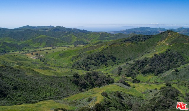 One of the last undeveloped major land parcels in California, Historic Rancho Cañada Larga has 6500 contiguous acres of rolling hills, streams, oak groves and pasturelands. Of the 18 legal parcels offered, 17 have certificates of compliance. Owned by the same family since 1977, this historic ranch is currently used only for cattle grazing. There are several premier locations on the ranch with ocean views, Ojai valley views, and prime building sites for smaller ranches.