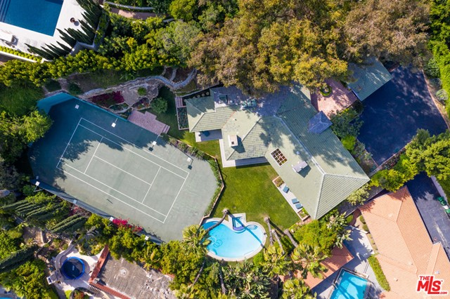 Ultra-private, gated, tennis court property set on just over 3/4 of a flat acre flag-lot. This is a hidden, quiet, prime development site. Seller is open to offers in BITCOIN or providing seller-financing. Home has recently under gone a major remodel. Once a 4br/5ba home, this residence has been converted into a 2br/3ba retreat. At just under 3,500sf, the Master is complete with vaulted ceilings, fireplace, sitting area, oversized walk-in closet and master bath. The guest quarters, in addition to all the living areas, open up to the park-like backyard with pool, rose garden, vegetable gardens and tennis court. Oversized kitchen, bar area, outdoor cave, skylights and more create the perfect understated, elegant escape in possibly the world's most coveted zip code, 90210. Conveniently located less than a mile from the Beverly Hills Hotel, 1.5 Miles to the shops on Rodeo Drive and SOHO House in West Hollywood!!!