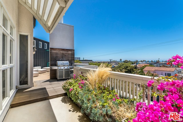 Step into a one of a kind, contemporary 3-story Santa Monica townhome with generous outdoor space on every level. Located just 3 blocks from the beach, this 2bd + loft, 3.5ba residence offers multiple environments for relaxed indoor/outdoor living. Enjoy al fresco dining on the outside patio off the gourmet kitchen & lounge areas, ending the day on the spacious roof deck, soaking in the sunset and views. The home features light and bright living spaces with dual sided-fireplace on the main floor, high ceilings and superb finishes throughout including Gaggenau & Sub-Zero appliances.  You'll love the layout with two en-suite bedrooms on the lower floor and a 3rd story loft bedroom/office space with private entrance & its own full bathroom making it ideal for work from home. The primary suite features lush private patio, fireplace & gorgeous private bath. With proximity to Main St., beaches & amenities this home has everything for the quintessential Southern California lifestyle!