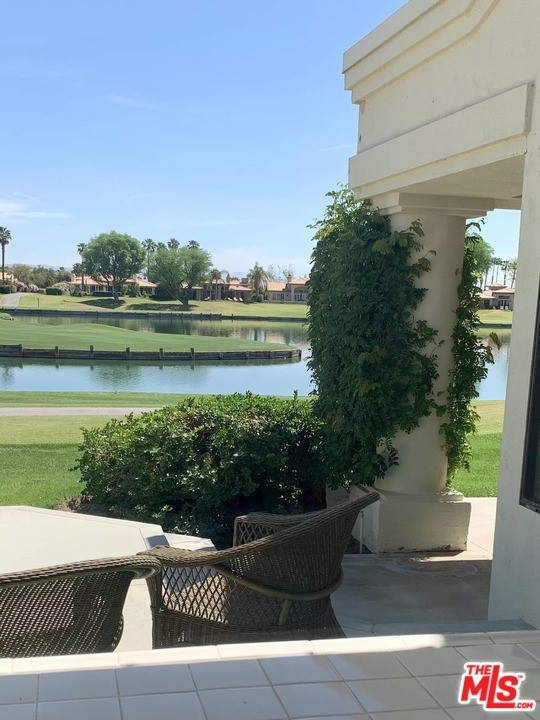 From the instant you enter the front door you will be mesmerized by the Incredible Shimmering Lake View! Overlooking the PC Stadium Course 6th hole drop zone and across the lake to the large penninsula green and on to the 7th Tee Box and Fairway. Private & quiet location, no golfballs here! These outstanding views are enjoyed not only from the entryway, kitchen, breakfast nook, wet bar and living room areas but also the Formal Dining Room. This 3 bedroom, 3 1/2 bath Legends 30 is mostly original and quite clean. The SS wall oven and microwave are only 2-3 years old, same with the carpet. Mostly furnished makes it easy to move-in and live, while contemplating future changes. Two car garage with utility sink and fairly new 50ga hot water tank. Features a golf cart garage also. The side yard is extra large, easily could handle the addition of a private pool & spa. The golf course facing patio is also extremely oversized.